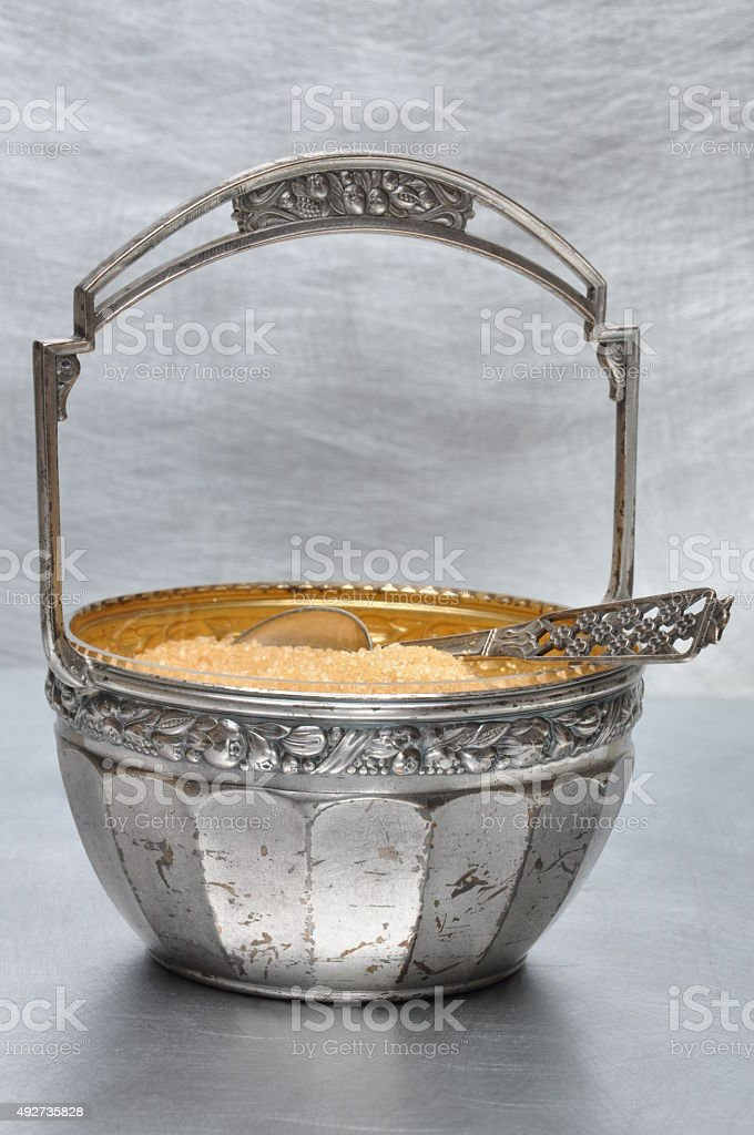 Silver-plated sugar bowl with spoon stock photo