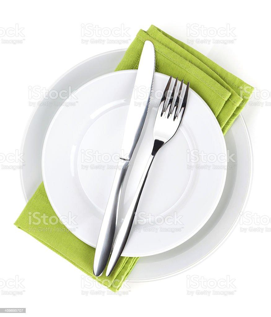 Silverware and napkins on plates stock photo