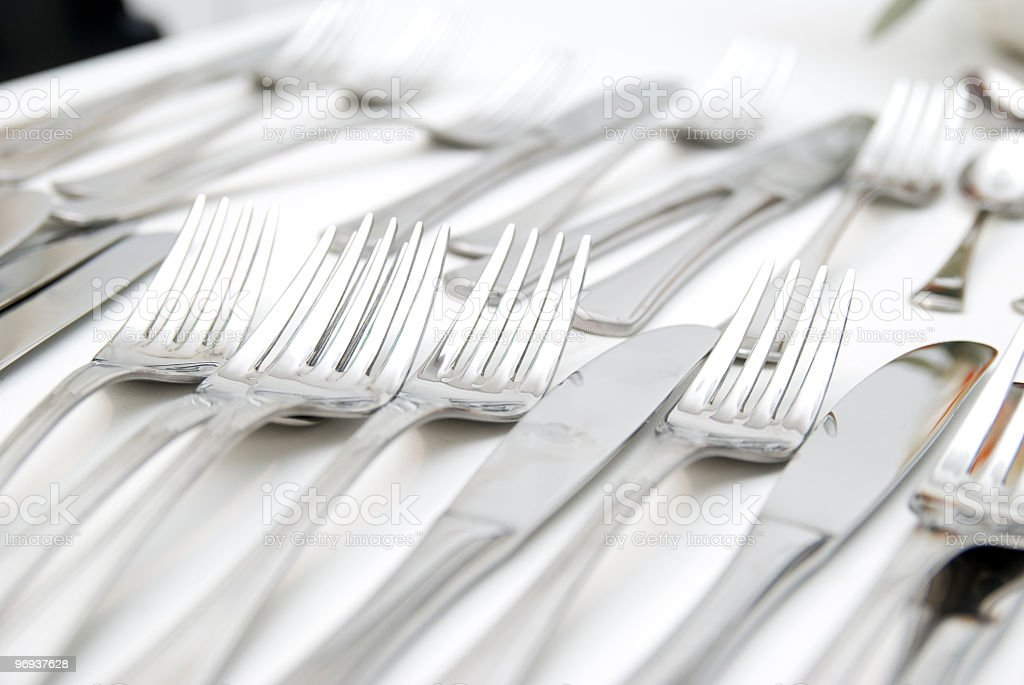 silverware lying on a table royalty-free stock photo
