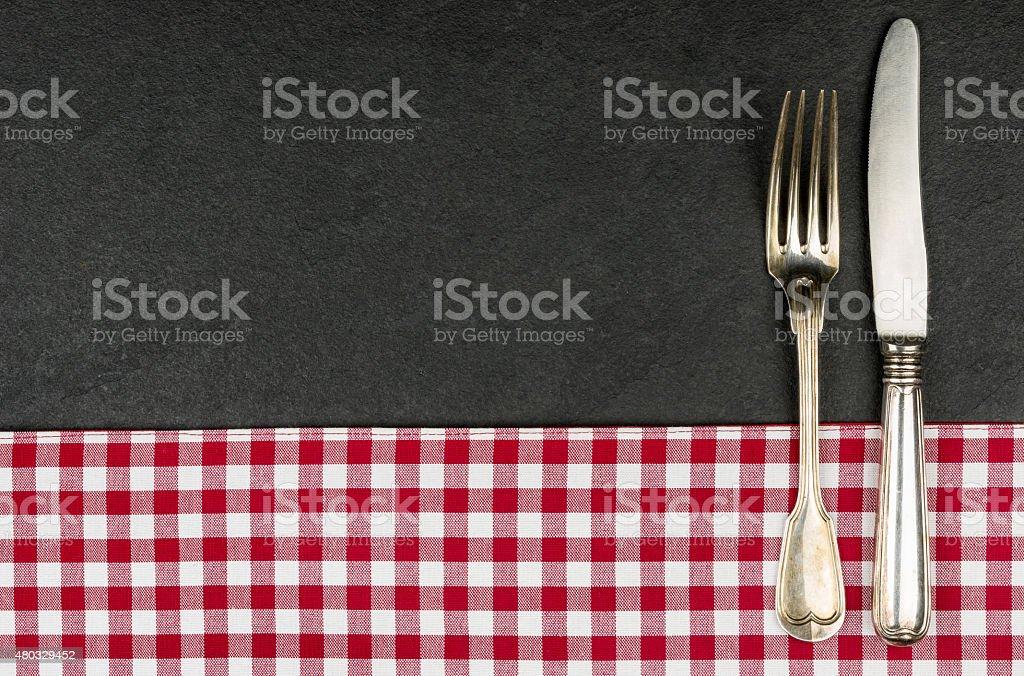 Silverware on a slate plate stock photo