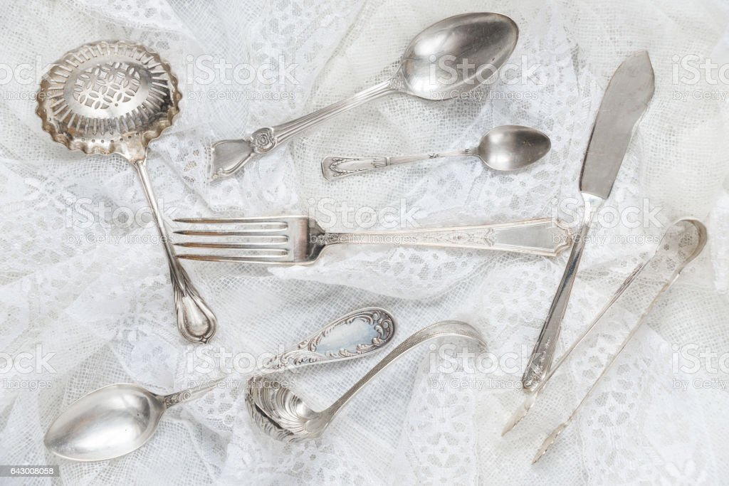 Silverware on a white lace stock photo