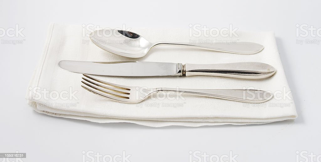 Silverware on white napkin stock photo