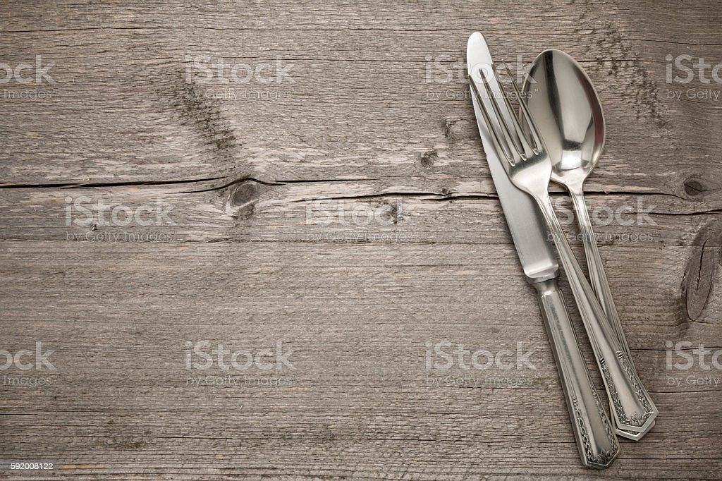 Silverware with an empty tag on a table stock photo
