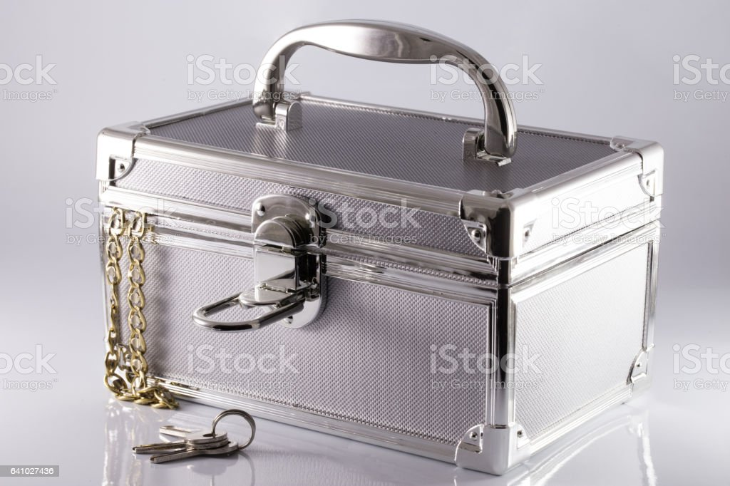 Silvery suitcase-box with keys and gold chain stock photo