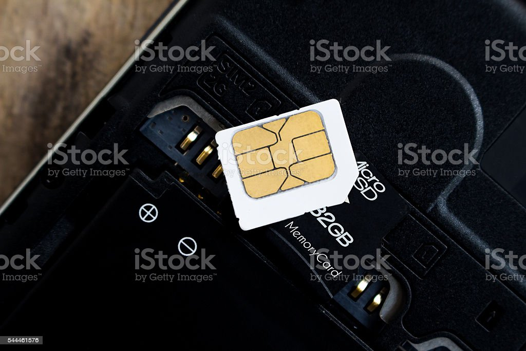 sim card and micro sd card on smart phone stock photo