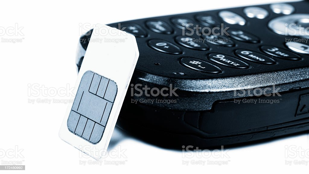 Sim card and mobile phone royalty-free stock photo