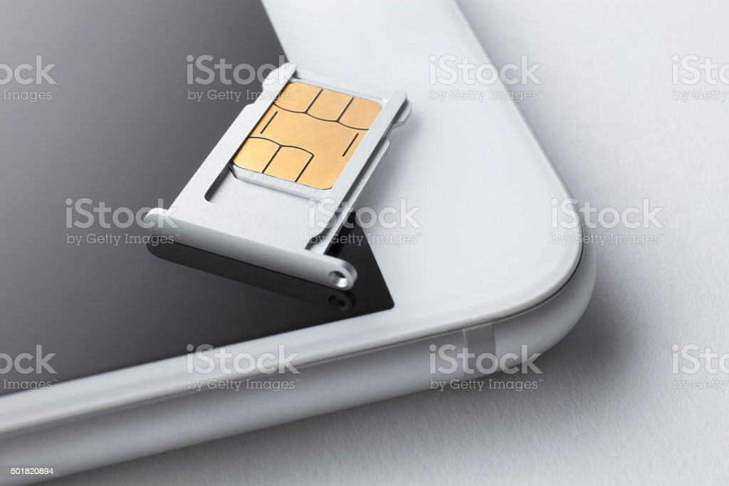 Sim card and smart phone stock photo