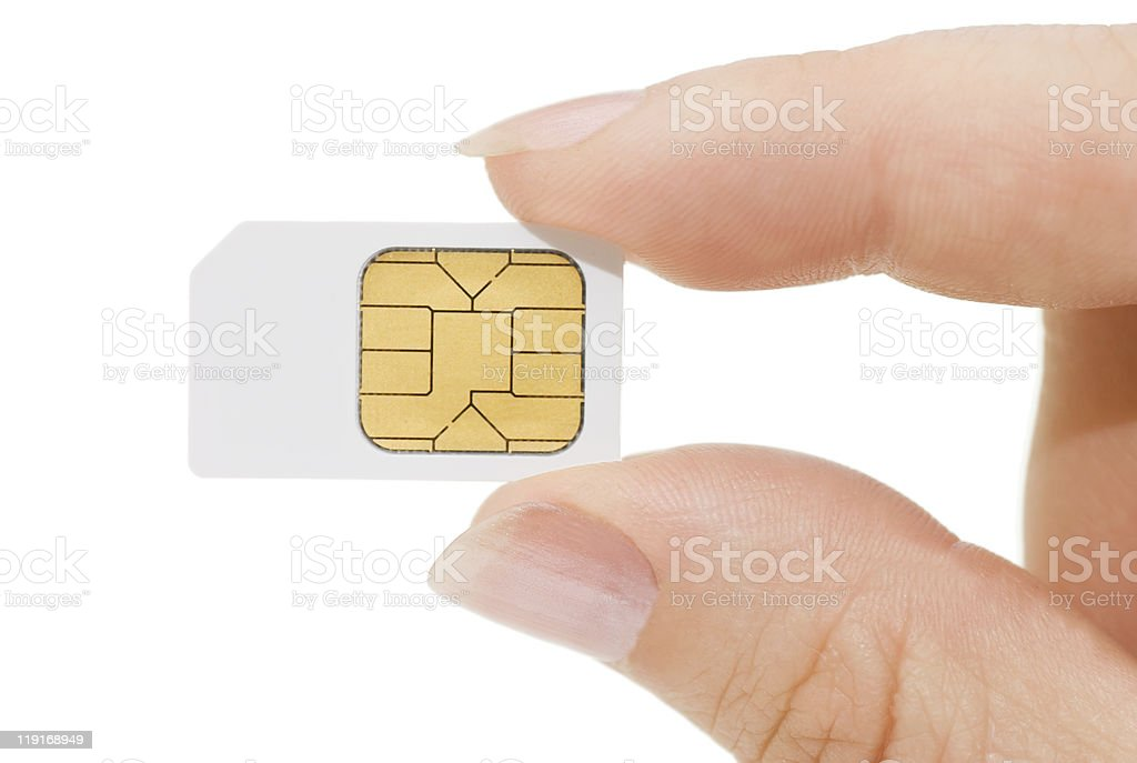 Sim card In a hand isolated on white background stock photo