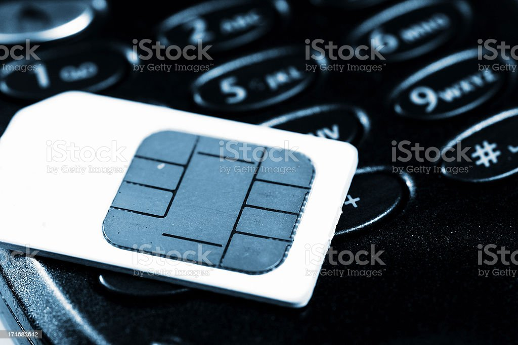 Sim card on top of black phone stock photo