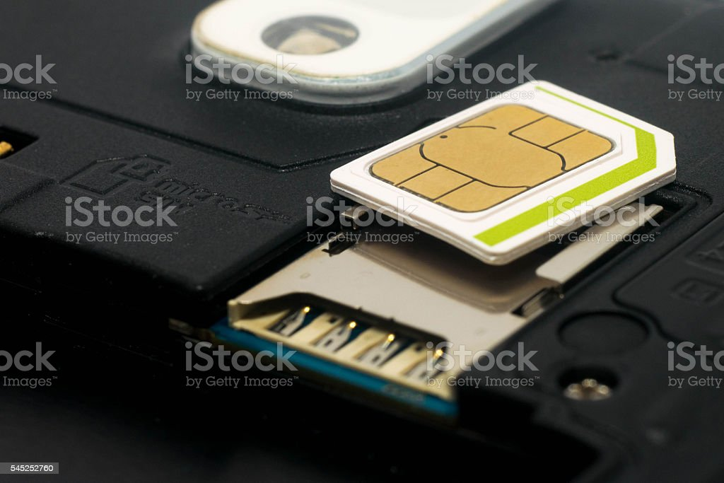 Simcard and slot for simcard inside mobile phone stock photo