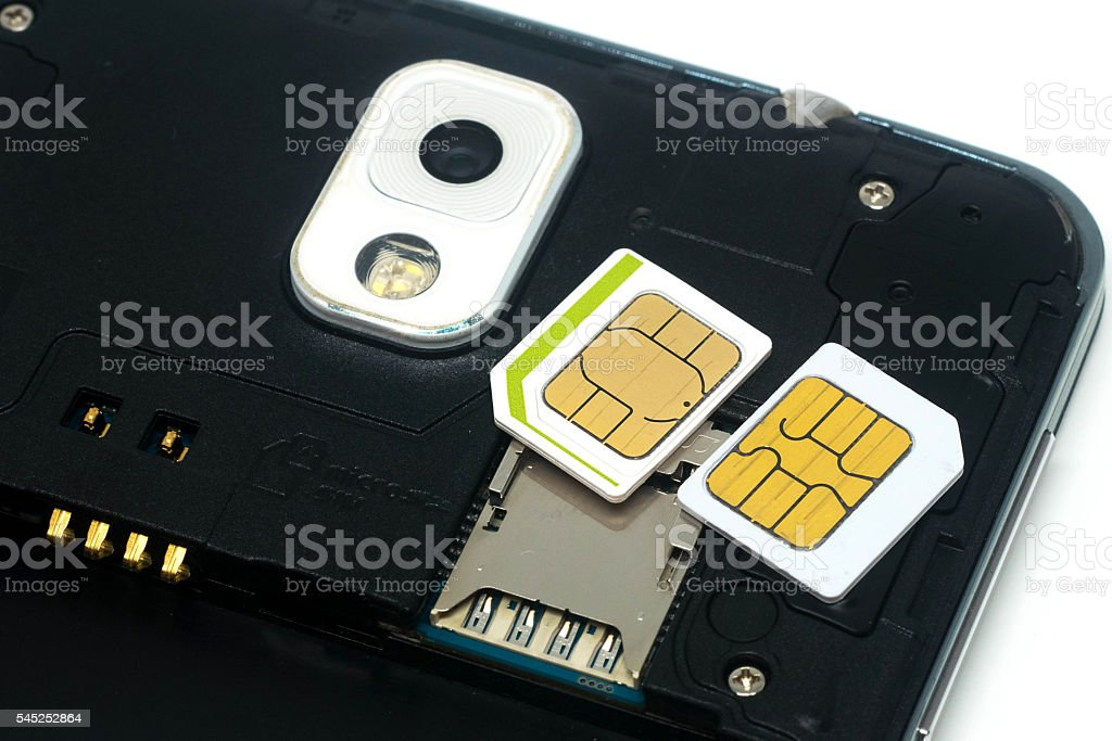 Simcards and slot for simcard inside mobile phone stock photo