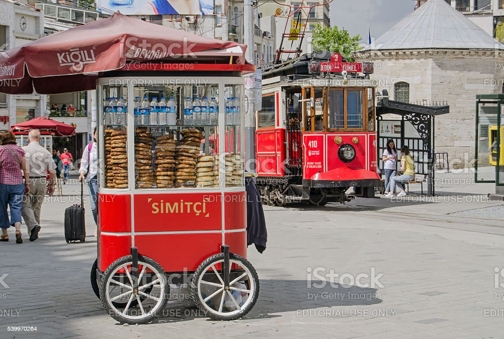 Simit Cart and Tram at Taksim Square, Istanbul stock photo
