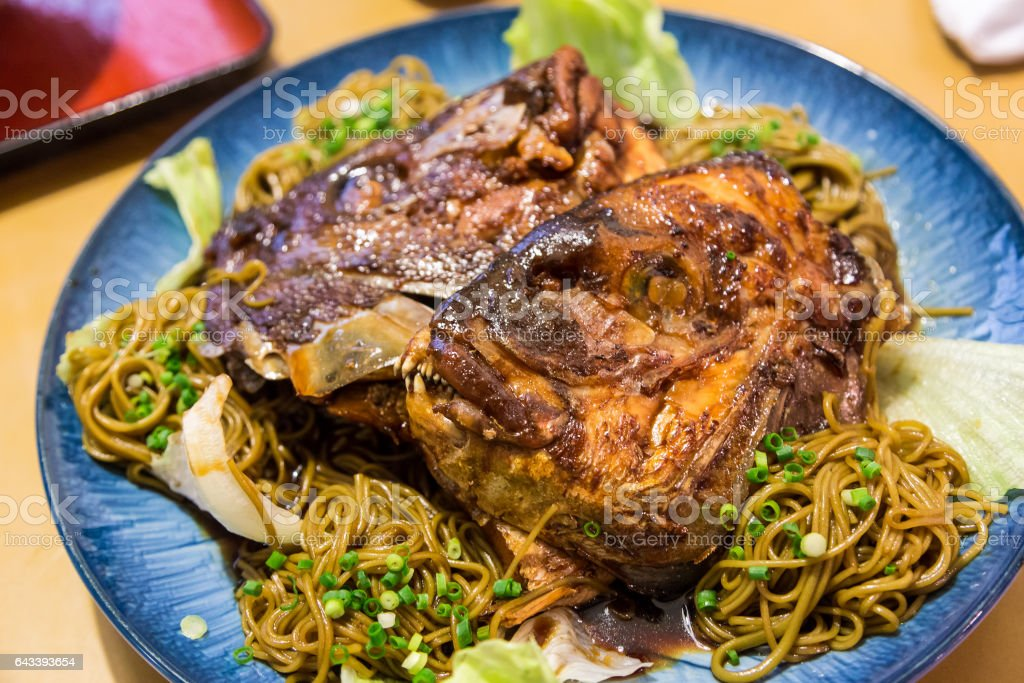 Simmered Sea Bream Head over noodle stock photo