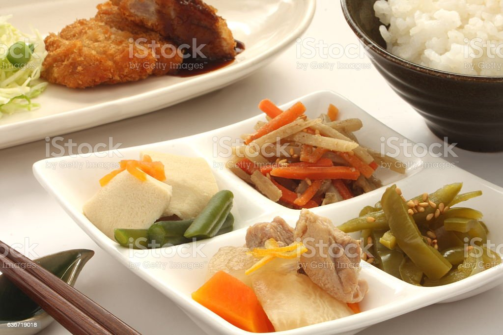 Simmered vegetable, deep fried pork and rice, typica Japanese food stock photo