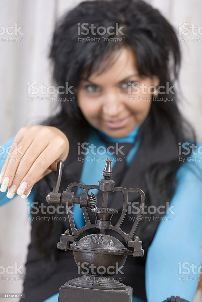 Simpatico Beauty is playing with old coffee beans grinding machine stock photo