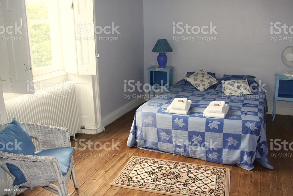Simple Bedroom For Rent In An Old French Chateau stock photo