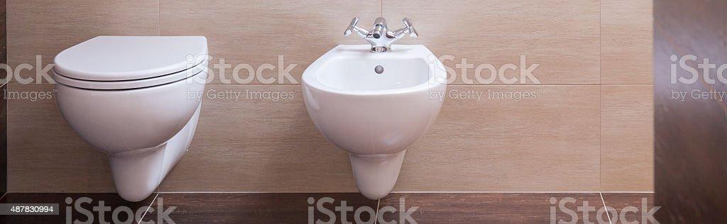Simple ceramic toilet and bidet stock photo