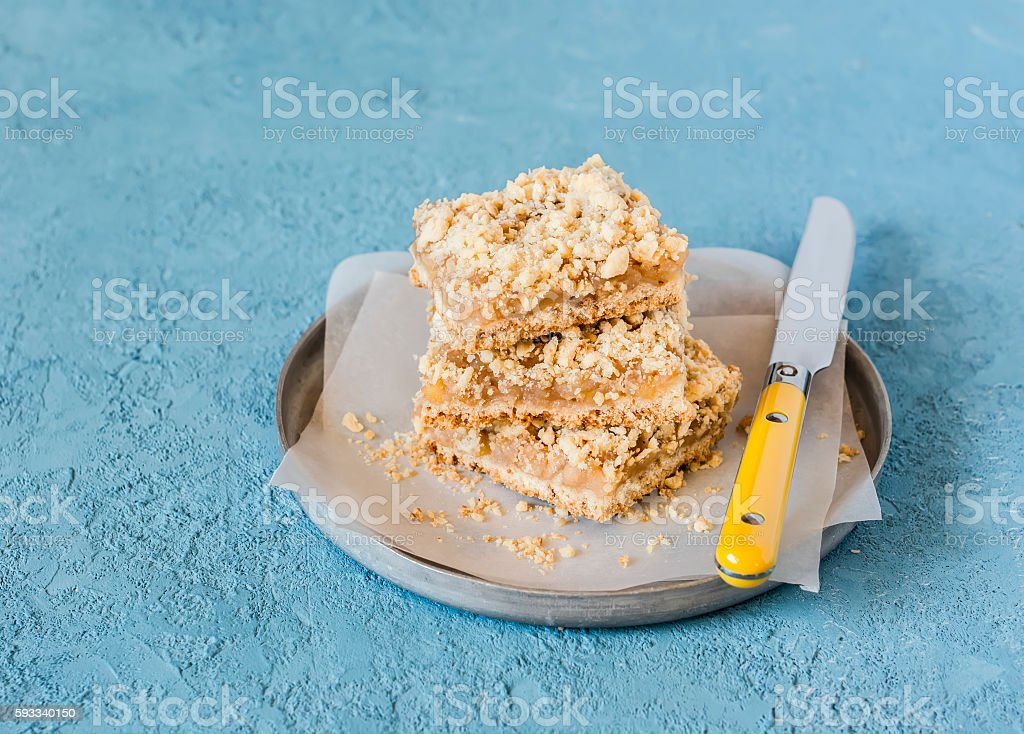 Simple delicious apple pie. Apple slices on a blue background. stock photo