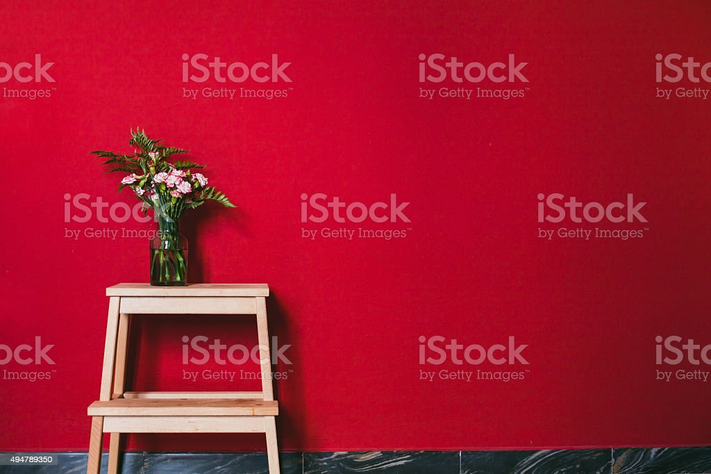 simple design of interior with red wall stock photo