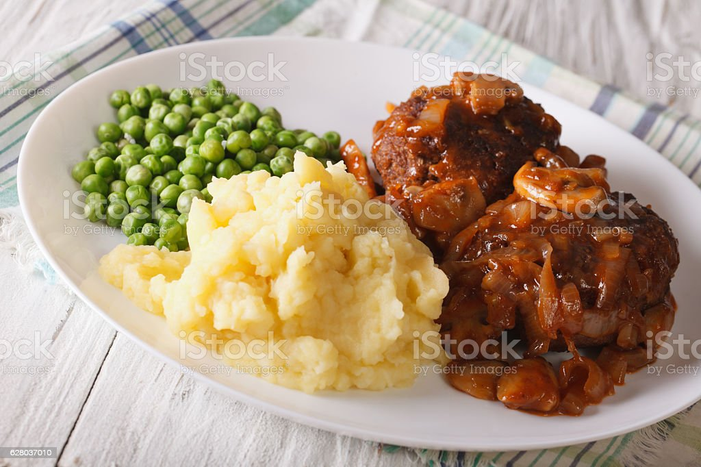 Simple Food: Salisbury steak with mashed potatoes and green peas stock photo
