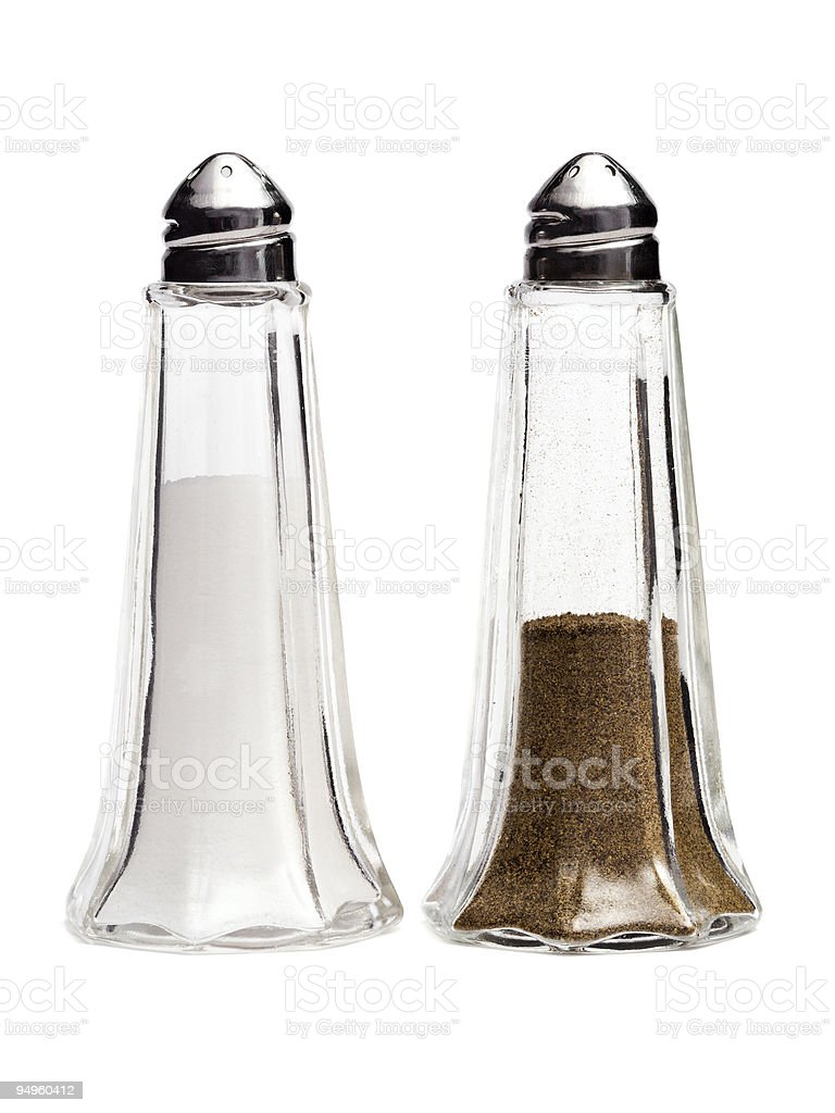 Simple glass salt and pepper condiment shakers stock photo