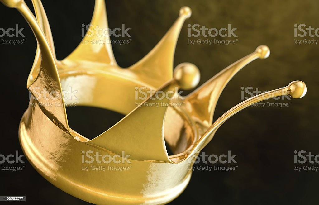 Simple gold crown on dark background royalty-free stock photo
