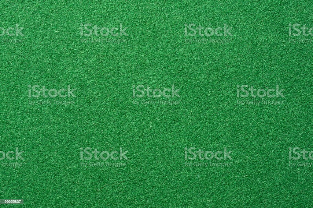 A simple green felt background stock photo