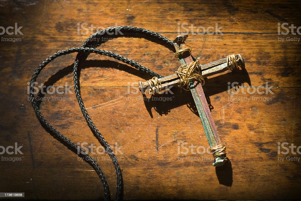 Simple Hand Made Cross on Old Wooden Bench royalty-free stock photo