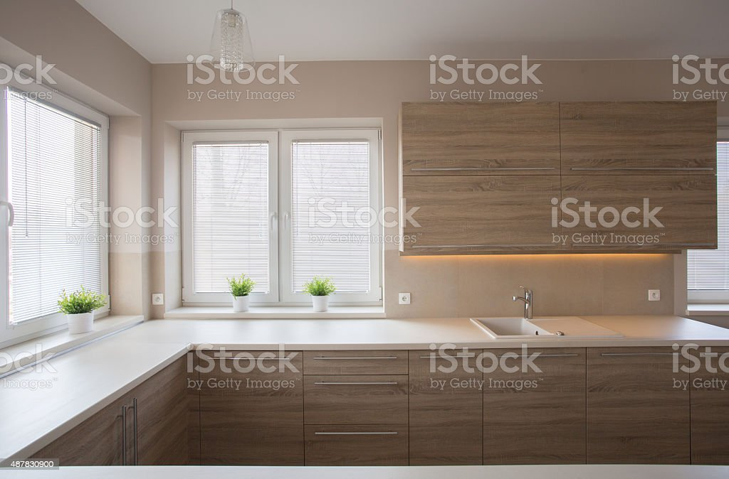 Simple kitchen with wooden furniture stock photo