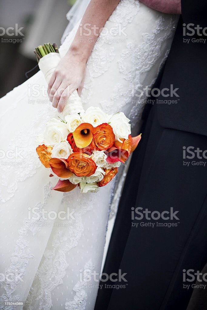 Simple Orange and White Wedding Bouquet held by Bride royalty-free stock photo