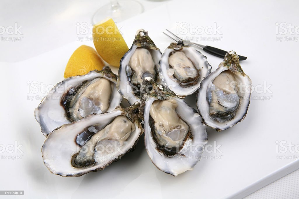 Simple Oysters on a flat white plate stock photo