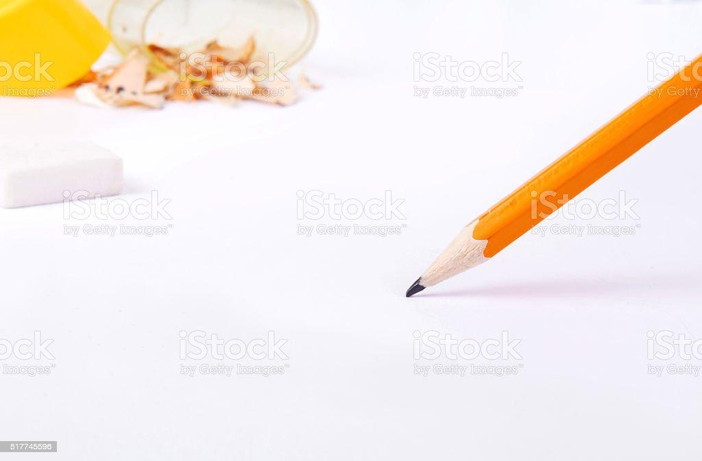 simple pencil on white paper closeup stock photo
