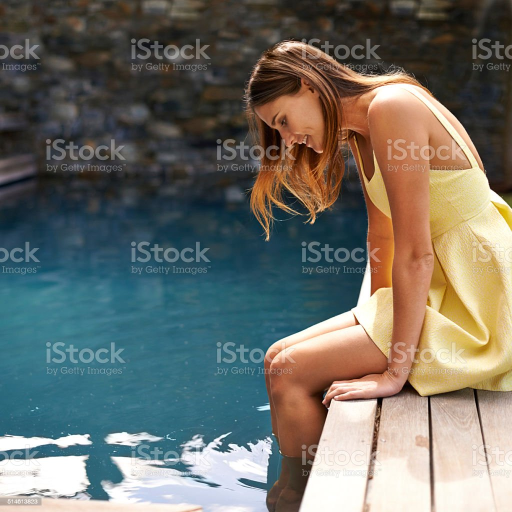 Simple pleasures by the pool stock photo