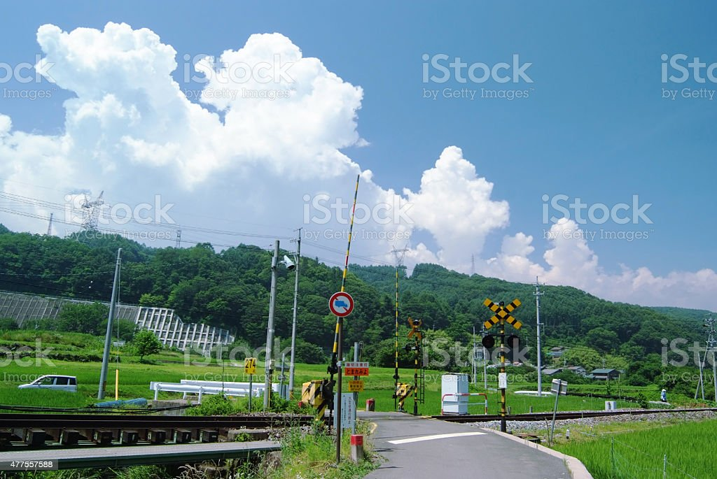 Simple railroad crossing in Japanese rural district stock photo