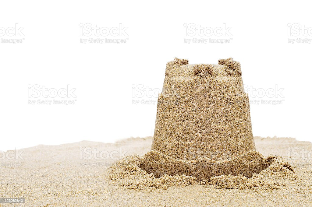 Simple sand castle on white background stock photo