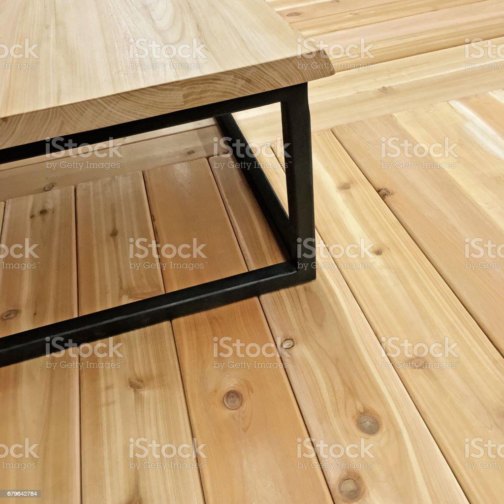 Simple table on wooden floor stock photo