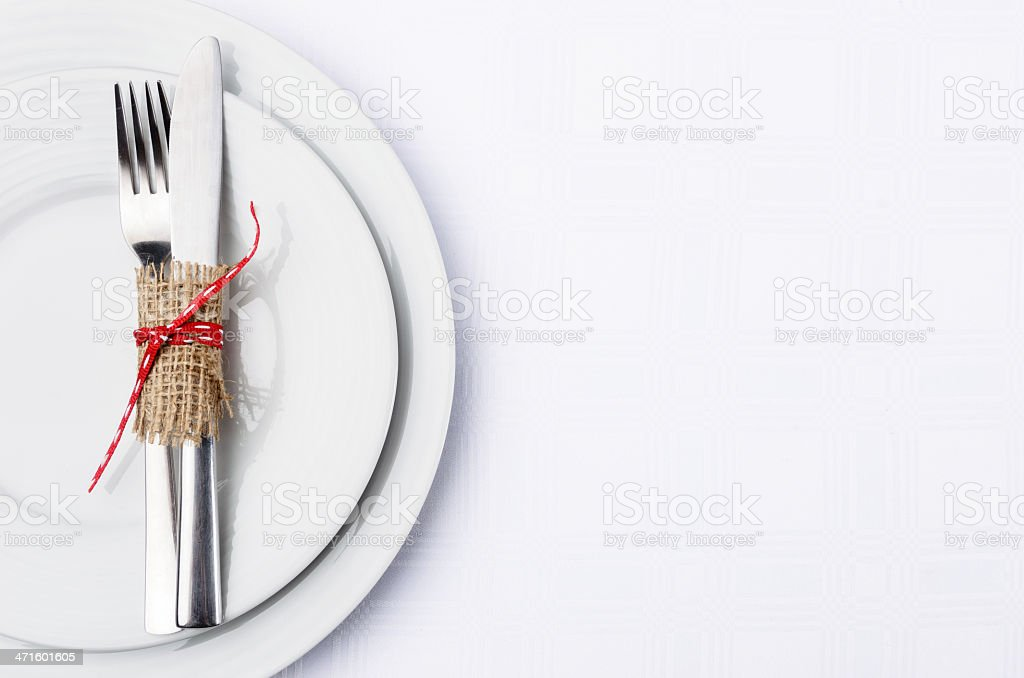Simple table setting with burlap and ribbon on white plates royalty-free stock photo