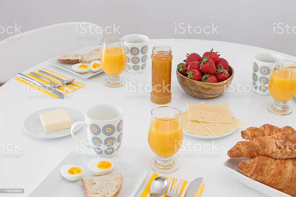 Simple tasty breakfast on a white table stock photo