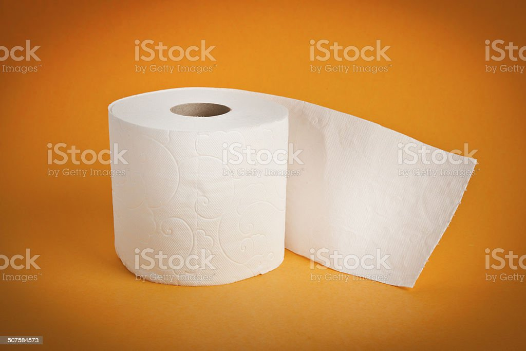 Simple toilet paper on yellow background stock photo