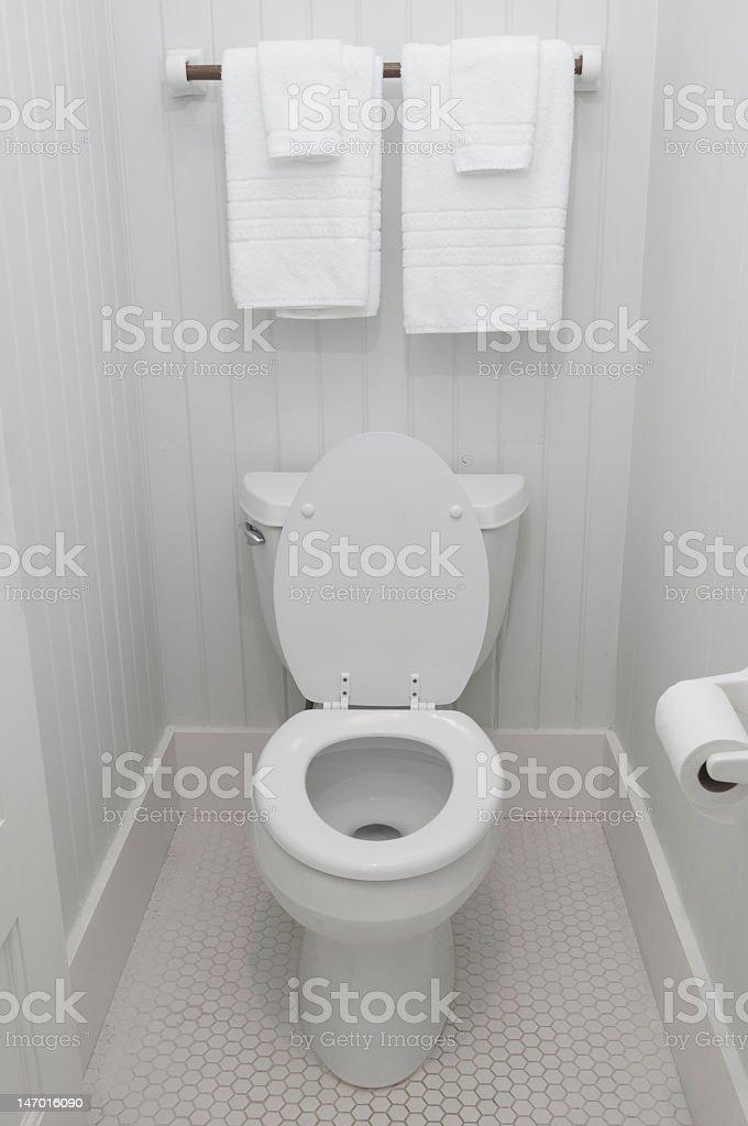 Simple white bathroom toilet lid up stock photo