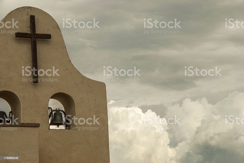Simple Wooden Cross and Bell on Church royalty-free stock photo