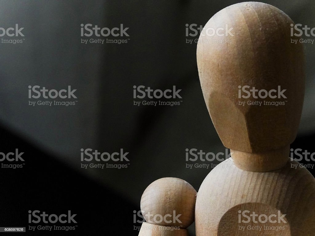 Simple wooden dummy makes a concept look stock photo