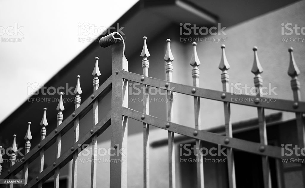 Simple yet sturdy entrance gate in front of house stock photo