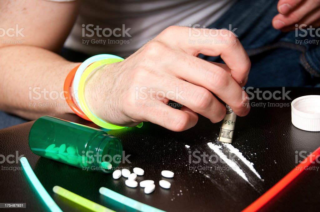 Simulated drug abuse concept stock photo