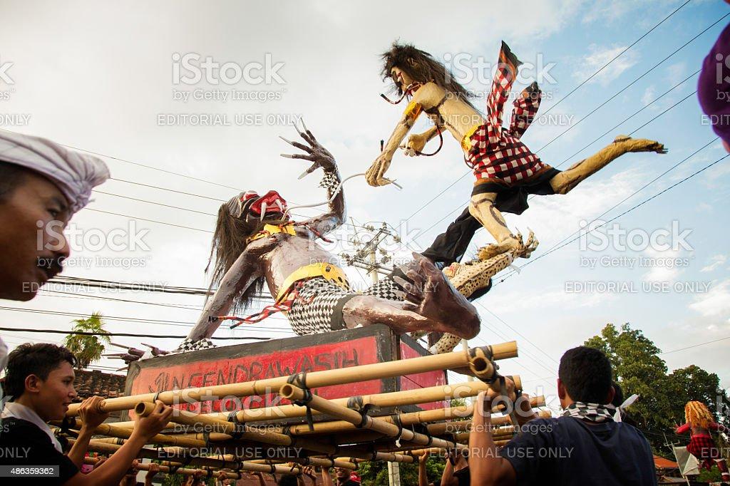 Simulated ogre battle during Nyepi Ngrupuk parade in Bali Indonesia stock photo