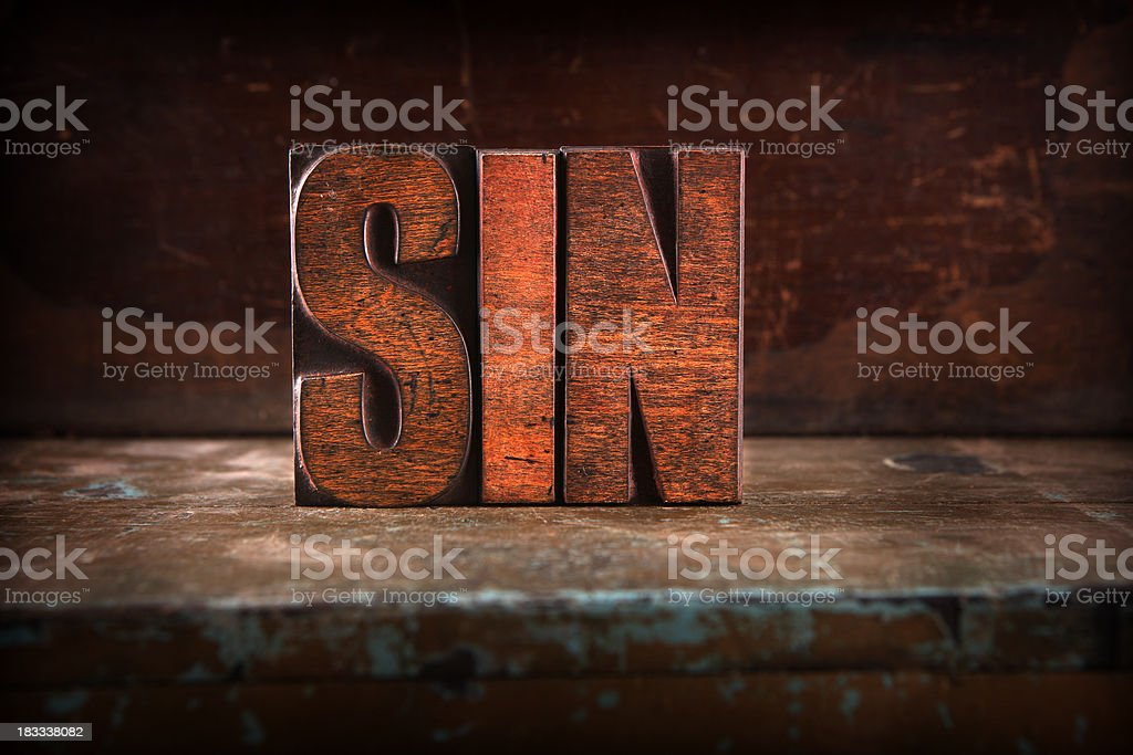 Sin - Letterpress letters stock photo