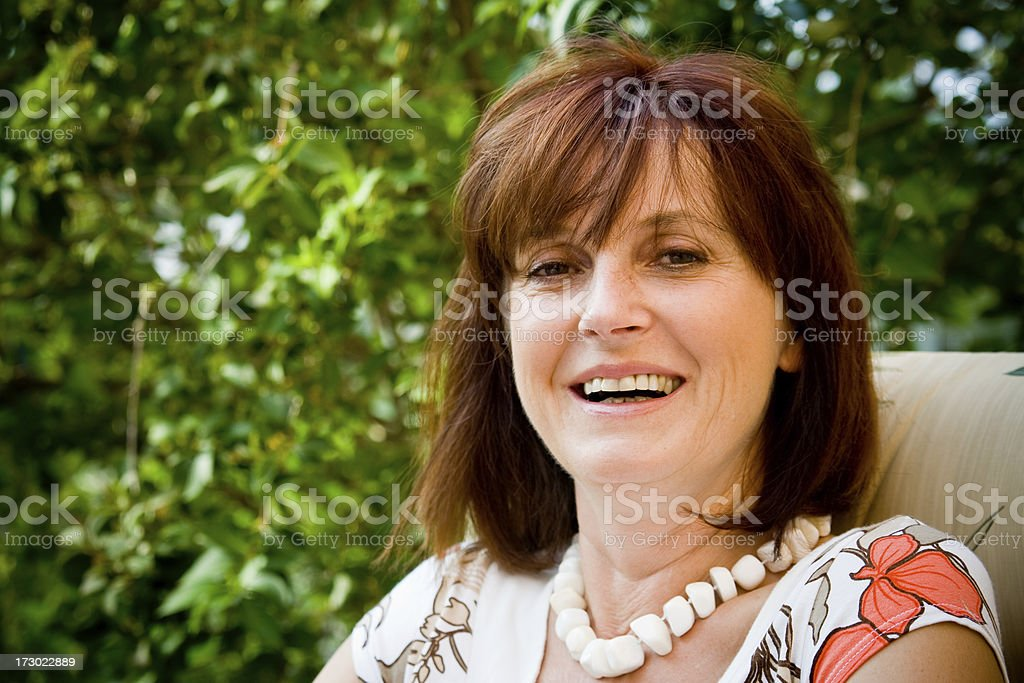 sincere smile of adult woman stock photo