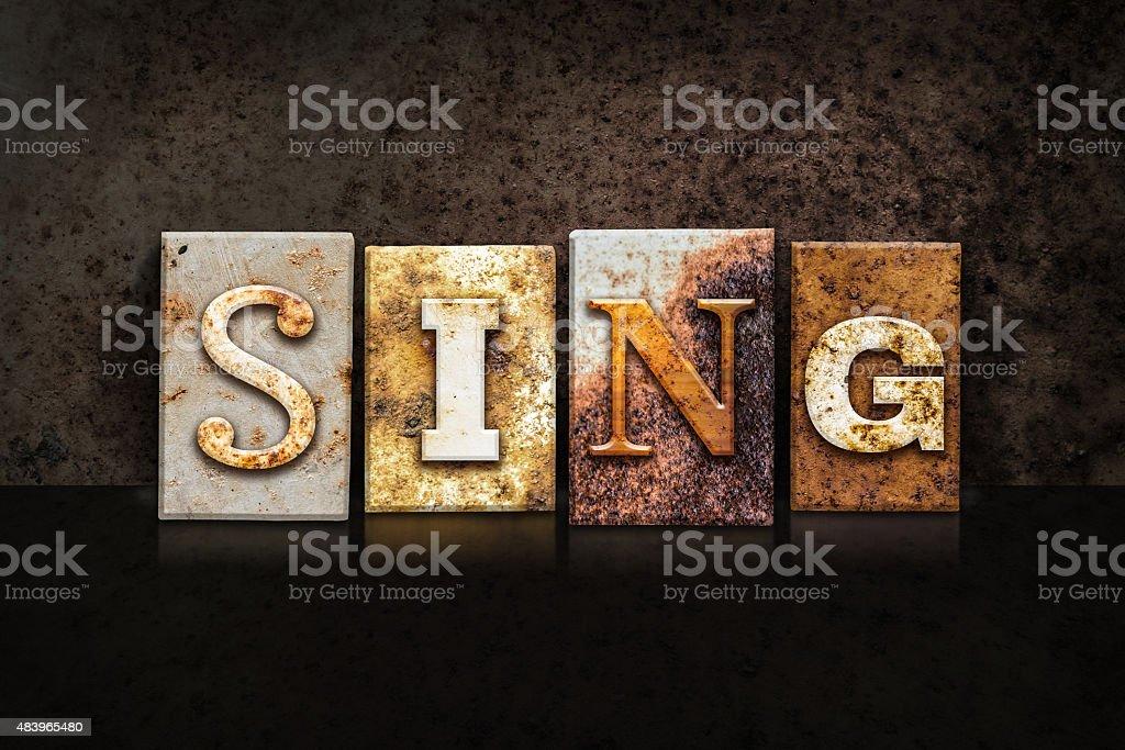 Sing Letterpress Concept on Dark Background stock photo