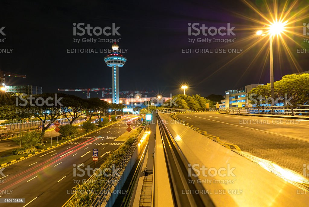 Singapore Changi Airport at night with air traffic control tower stock photo