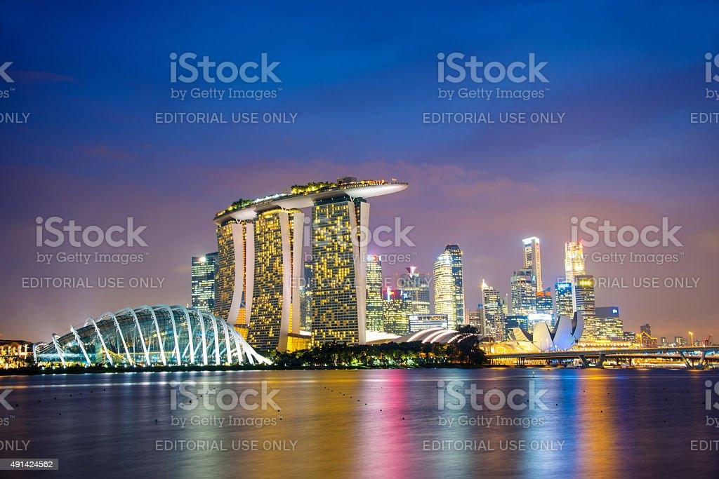 Singapore city skyline by night with Marina Bay Sands stock photo